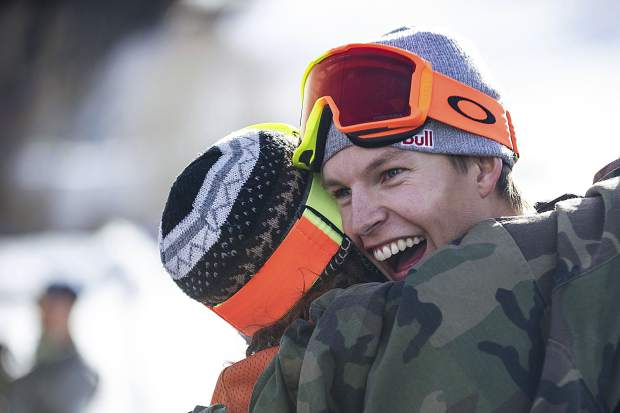 Oystein Braaten right, gets a hug from Henrik Harlaut after his third run for the men's ski slopestyle finals at the Winter X Games on Sunday, Jan. 28 in Aspen.