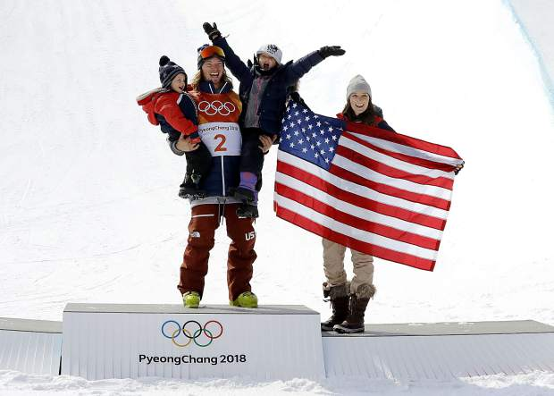 Gold medal winner David Wise, of the United States, celebrates with his wife, Alexandra, and with their children, 3-year-old Malachi, left, and 6-year-old Nayeli, after the men's halfpipe final at Phoenix Snow Park at the 2018 Winter Olympics in Pyeongchang, South Korea, Thursday, Feb. 22, 2018. (AP Photo/Lee Jin-man)