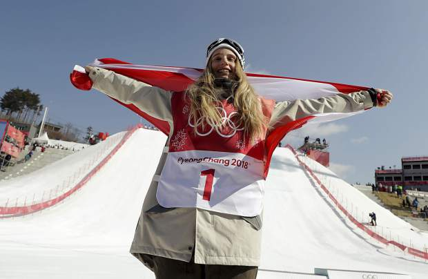 Anna Gasser, of Austria, celebrates after winning the gold medal in the women's Big Air snowboard final at the 2018 Winter Olympics in Pyeongchang, South Korea, Thursday, Feb. 22, 2018. (AP Photo/Matthias Schrader)