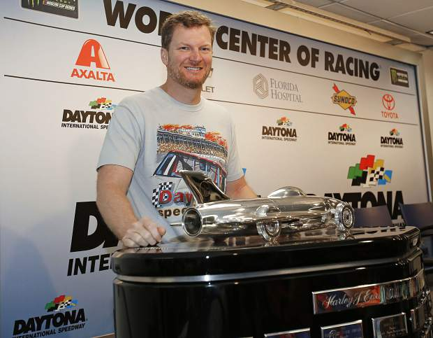 Dale Earnhardt Jr. poses with the Harley J. Earl trophy during a news conference before the NASCAR Daytona 500 Cup series auto race at Daytona International Speedway in Daytona Beach, Fla., on Sunday, Feb. 18, 2018.