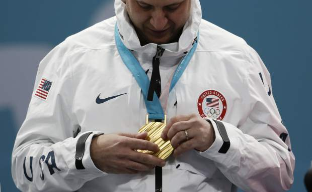 United States's skip John Shuster holds his gold medal after winning the men's final curling match against Sweden at the 2018 Winter Olympics in Gangneung, South Korea, Saturday, Feb. 24, 2018. (AP Photo/Natacha Pisarenko)