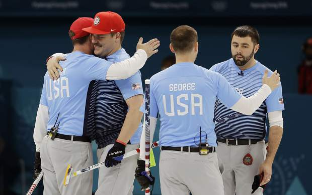 United States team members celebrate winning a men's curling match against Britain at the 2018 Winter Olympics in Gangneung, South Korea, Wednesday.