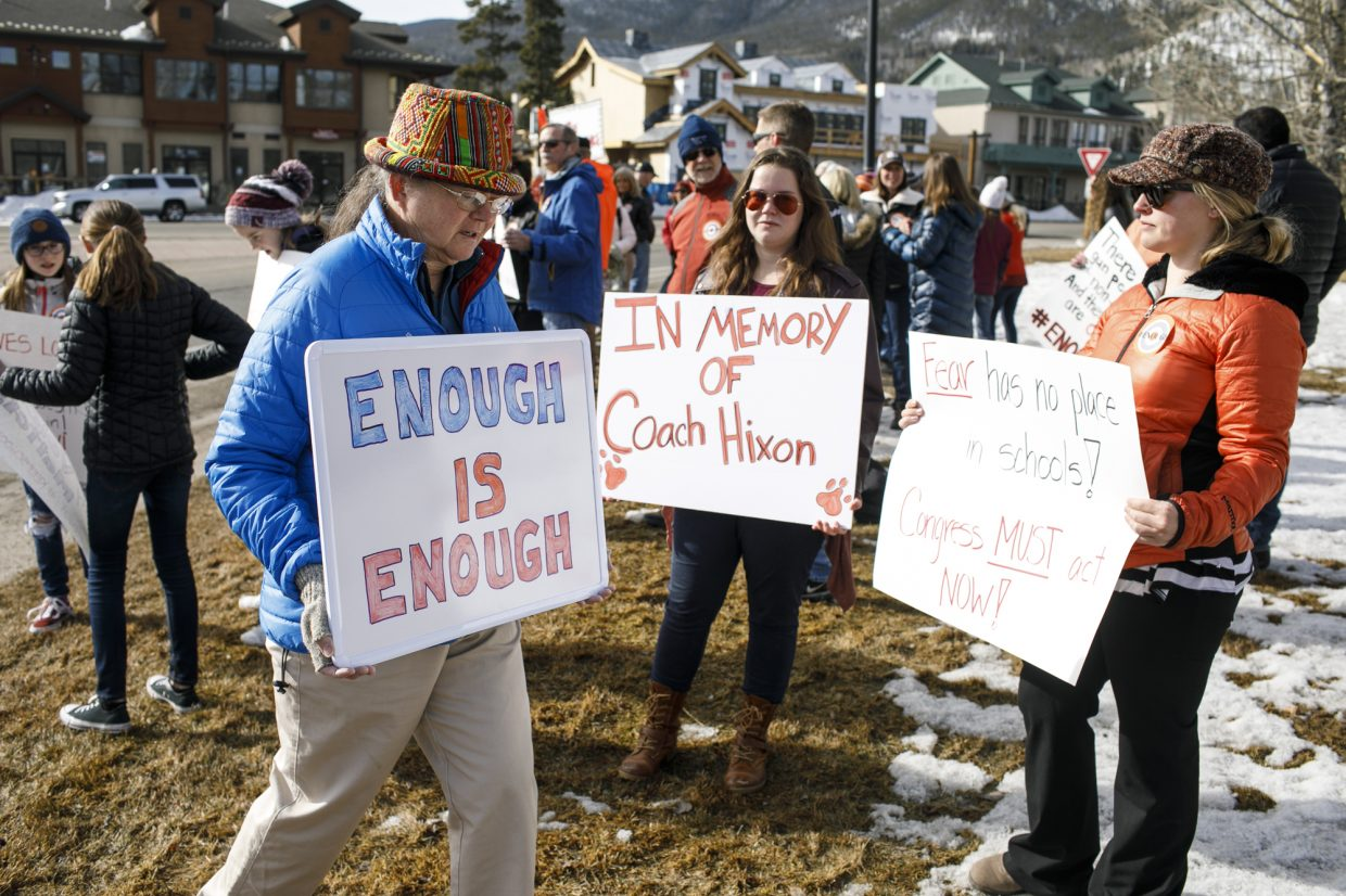 People rally at Frisco's Main Street entrance for the