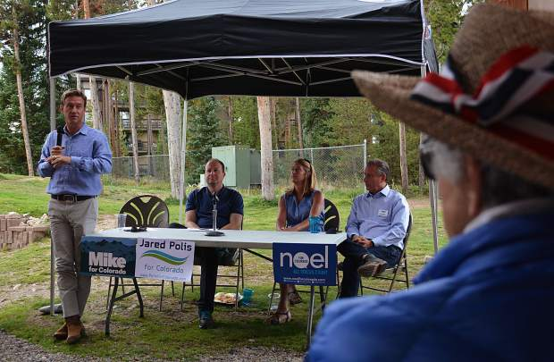 Four presumed frontrunners for governor from the Democratic Party visited Breckenridge's Carter Park on Sunday afternoon to speak with loyalists over lunch. From left to right, former state Sen. Mike Johnston, U.S. Rep. Jared Polis, former State Treasurer Cary Kennedy and Denver businessman Noel Ginsburg.
