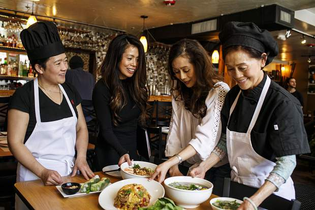 Sisters from left to right, Trang, Lua, and Khanh, with their mother Lien Nguyen presents the Peak of Asia's Vietnamese dishes inside the restaurant Thursday, March 8, in Breckenridge.
