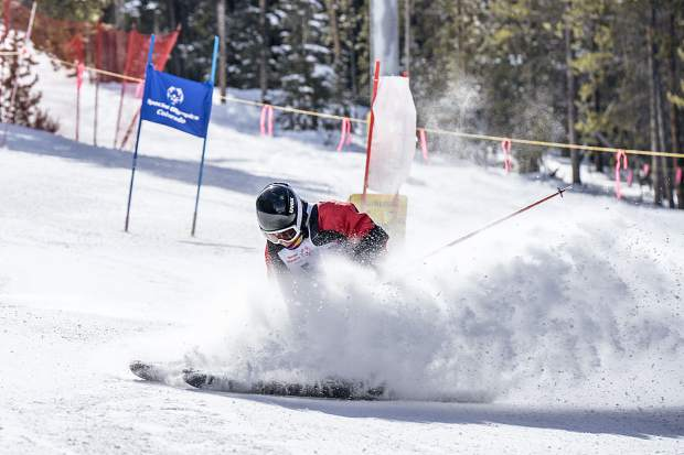 As a Special Olympics skier makes a turn, he leaves a cloud of snow at the Special Olympics colorado Winter Games at Copper Mountain Resort.