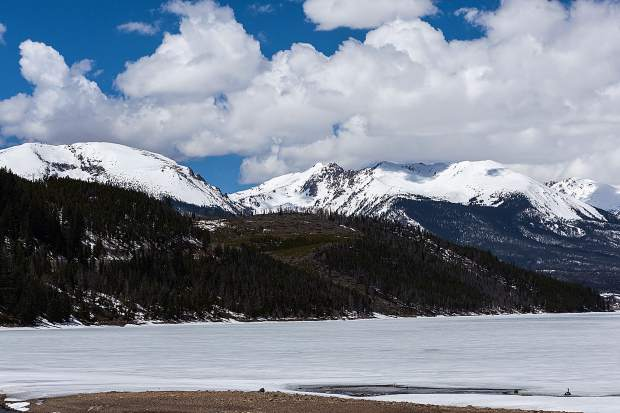 Buffalo Mountain and Red Peak as seen from Summit Cove. One Canadian Goose near the edge of the shore.