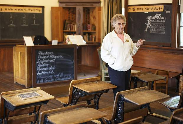 Summit Historical Society presenter and local author Sandra Mather leads a tour in the 1883 Schoolhouse museum on Aug. 8, 2017 in Dillon.