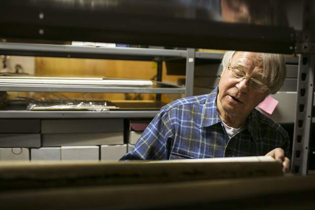 Rick Hague takes a look in the historical item's archives inside the Dillon Schoolhouse Museum Wednesday, April 25, in Dillon.