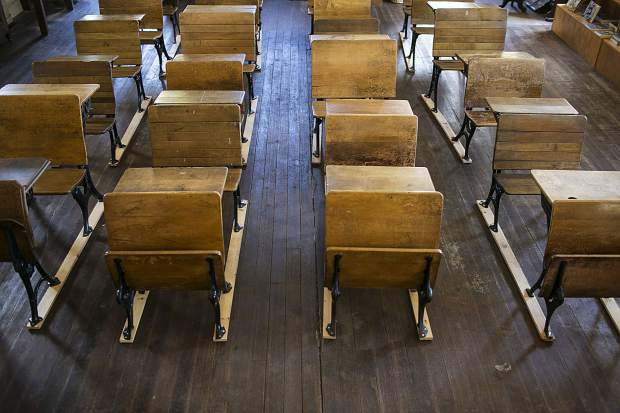 Old desks inside the Dillon Schoolhouse Museum Wednesday, April 25, in Dillon.