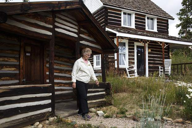 Former Summit Historical Society president and local author Sandra Mather walks out of a homestead building, built in the 19th century, during a weekly tour for guests on Aug. 8, 2017 in Dillon.