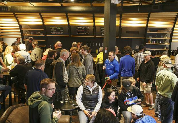 High Side Brewery's first costumers packed the bar area during the opening day Friday, May 18, on Main Street in Frisco.