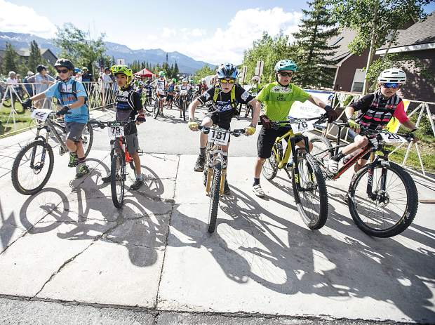 Junior Boys 11-12 participants including Louis Calkin (center) take to the starting line at Wednesday evening's second event of this summer's Summit Mountain Challenge mountain bike race series, the Gold Run Rush, which took place in and around the Wellington neighborhood of Breckenridge.