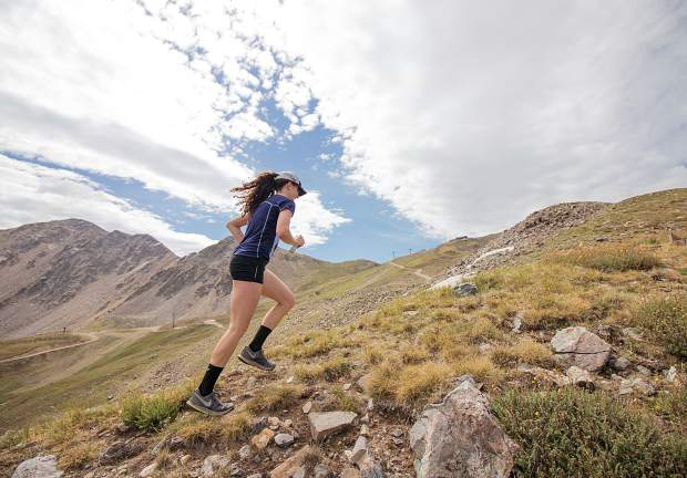 A woman runs up Arapahoe Baskin Ski Area during Sunday's second of two summer trail run events.