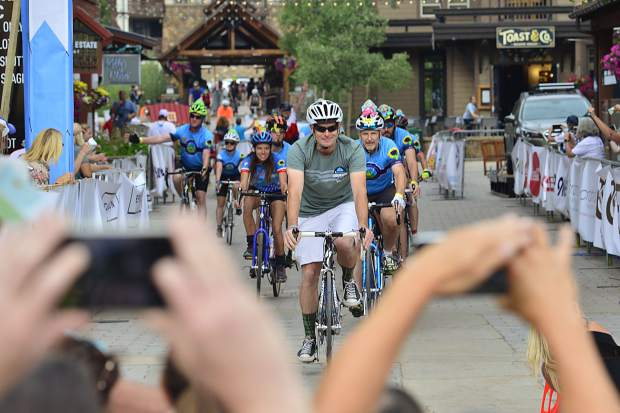 Riders cross the finishing at the 29th Courage Classic on Sunday at Copper Mountain. The annual two-day bicycle tour is the single-biggest fundraiser of the year for Children's Hospital Colorado.