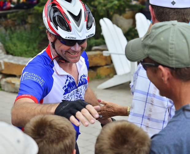 One of the participants in the Courage Classic gets hugs from his supporters after crossing the finish line on Sunday at Copper Mountain.