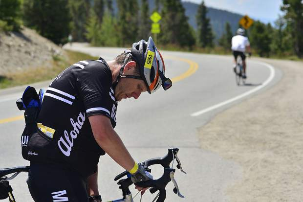 Aaron Svoboda takes a break after reaching the top of Swan Mountain on Sunday during the Courage Classic, a two-day bicycle tour in support of Children's Hospital Colorado.