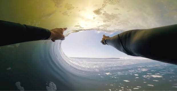 In this image made from video provided by Chris Rogers, surfer Koa Smith points at a wave during his two-minute ride off the coast of Namibia on the western shore of Africa. Smith rode the wave for nearly a mile and stayed upright as he traveled through eight barrels -- the hollow formed by the curve of the wave as it breaks over the surfer's head. (Chris Rogers via AP)