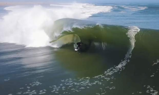 In this image made from video provided by Chris Rogers, surfer Koa Smith rides a wave off the coast of Namibia, on the Western shore of Africa. Smith rode for nearly a mile over a 120-second span and stayed upright as he traveled through eight barrels -- the hollow formed by the curve of the wave as it breaks over the surfer's head.