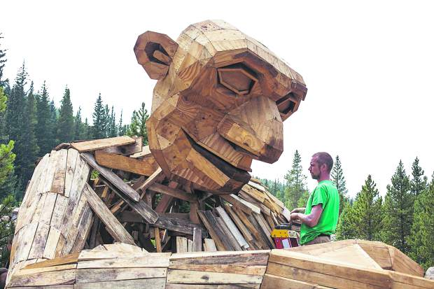 "Danish artist Thomas Dambo builds the troll ""Isak Heartstone"" along Wellington Trail as part of the Breckenridge International Festival of Arts on Tuesday, Aug. 7, in Breckenridge."