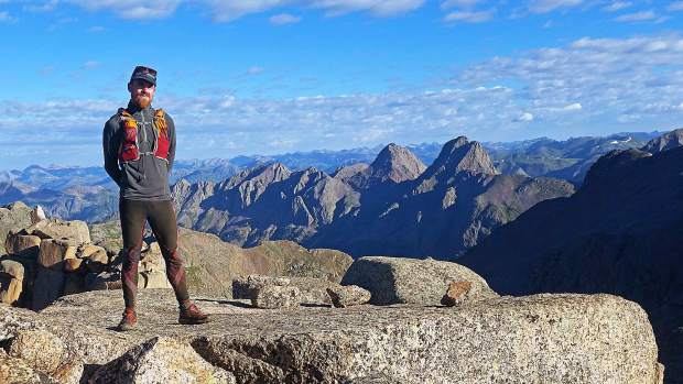 Justin Simoni, 37, of Boulder poses for the camera at the 13,924-foot summit of Jagged Peak in the San Juans last summer. During his presentation about his summer 2017 self-supported hike-and-bike scaling of the 105 highest mountains in Colorado, Simoni said Jagged Peak may been the toughest mountain he had to climb during his odyssey.