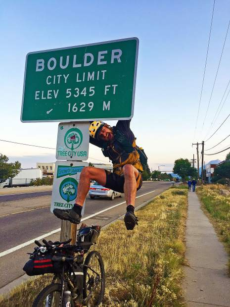 After pedaling 40 miles from the trailhead of Long's Peak, Justin Simoni decided to climb the Boulder city limits sign upon his return to his hometown after 60-plus days out on the trails. Long's Peak was the final of the 105 highest mountains in Colorado that Simoni climbed during his self-supported hike-and-bike scaling of this state's 105 highest points in the summer of 2017.