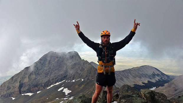 Justin Simoni, 37, of Boulder rejoices while summiting 14,351-foot Blanca Peak during his summer 2017 self-supported bike-and-hike journey during which he scaled the 105 highest mountains in Colorado. On Wednesday, he spoke about the odyssey to local Summit County folk at Wilderness Sports in Dillon.