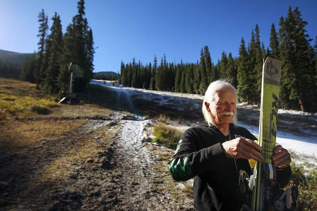 Silverthorne resident Steve Plummer, who has skied every month for 10 years here in Summit County using both man-made and natural snow, straps together his downhill