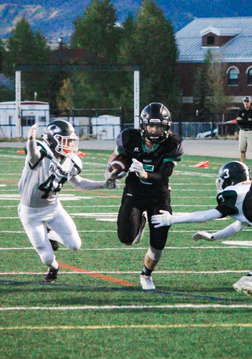 Summit Tigers sophomore running back Noah Martens rushes through a gap in the Woodland Park line of scrimmage during the Tigers' 38-30 win at Tiger Stadium in Breckenridge Friday night.