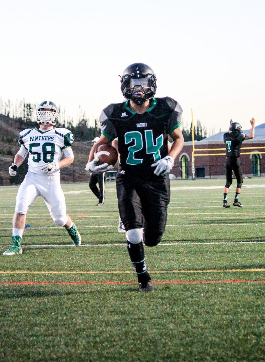 Summit Tigers junior running back Brandon Montealegre crosses the goal line during the Tigers 38-30 win over Woodland Park at Tiger Stadium in Breckenridge Friday night.
