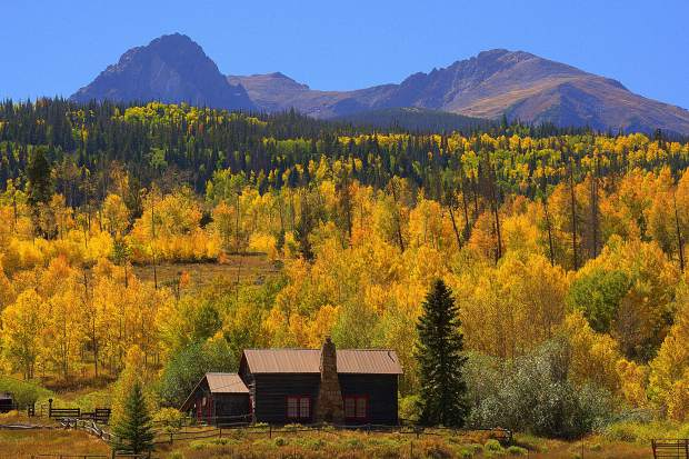 """House on Oxbow Ranch just north of Silverthorne takes on a distinctively Colorado aura in fall. """"And all at once, summer collapsed into fall,"""