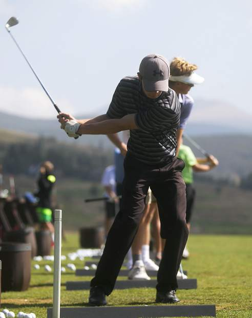 Summit High School senior golfer Logan Pappas focuses on the ball during a back swing while practicing on the driving range at Keystone Ranch Golf Course on Aug. 23, near Dillon.