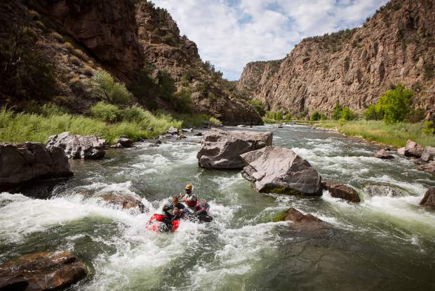 Paddling a tandem packraft through one of the many rapids in Black Canyon of the Gunnison National Park.