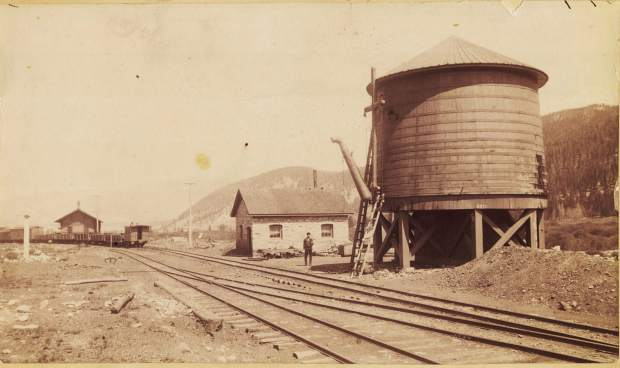 Dickey Pump House, Water Tank, and Depot, circa 1890. A northbound (shown as west bound on schedule) freight train waits in front of the depot on its way to Frisco. A well, whose shingled conical roof can be seen behind the ladders at the water tank, supplied the 47,500-gallon water tank.