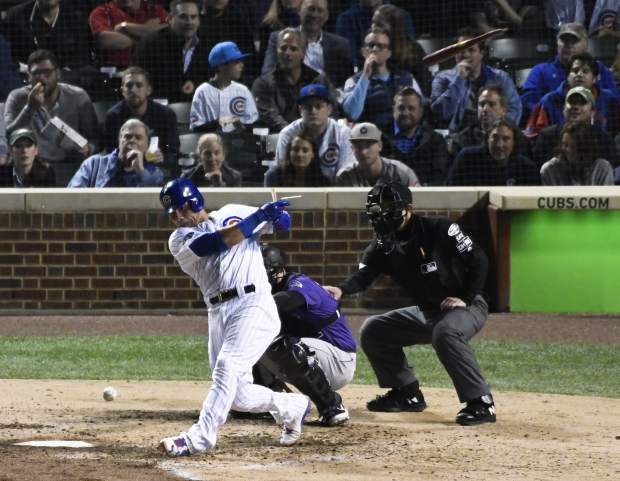 Chicago Cubs' Willson Contreras (40) breaks his bat as he grounds out against the Colorado Rockies during the fifth inning of the National League wild-card playoff baseball game, Tuesday, OCT. 2, 2018, in Chicago.