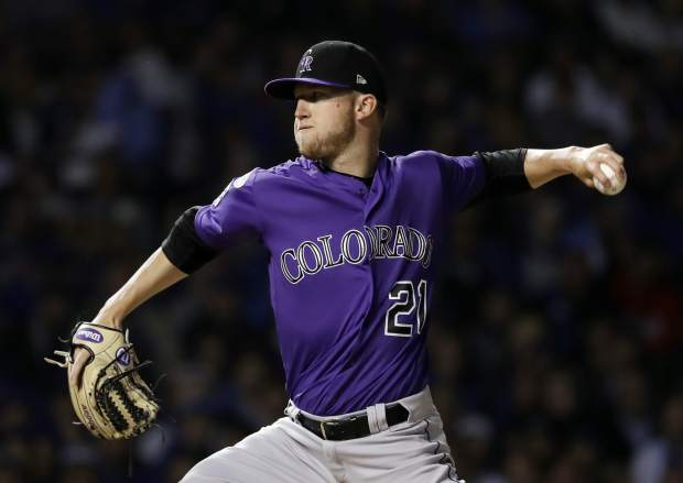 Colorado Rockies starting pitcher Kyle Freeland throws against the Chicago Cubs during the first inning of the National League wild-card playoff baseball game Tuesday, Oct. 2, 2018, in Chicago.