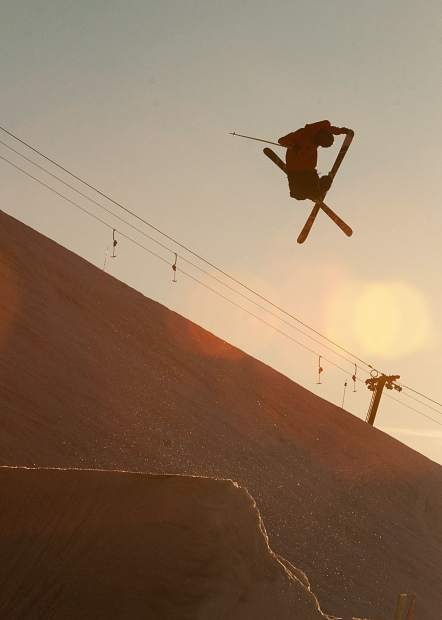 Former Canadian national ski team developmental coach Mike Shaw executes a trick on his skis.