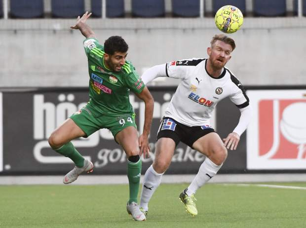 Dalkurd's Ferhad Ayaz, left, in action with Orebro's Michael Almeback during their Swedish League soccer match on Saturday at Gavlevallen soccer field in Gavle, Sweden. The 14-year journey of the soccer team known as Dalkurd began as a social project to get misbehaving kids off the street in a rural town in central Sweden. Now, it has grown into a top-flight squad that has given the Kurdish minority - scattered and ravaged by war - something to cherish as its own.