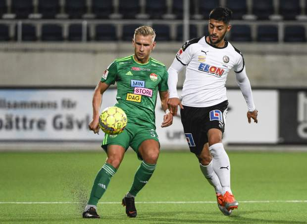 Dalkurd's Simon Strand, left, in action with against Orebro's Rodin Deprem, during their Swedish League soccer match on Saturday at Gavlevallen soccer field in Gavle, Sweden. The 14-year journey of the soccer team known as Dalkurd began as a social project to get misbehaving kids off the street in a rural town in central Sweden. Now, it has grown into a top-flight squad that has given the Kurdish minority - scattered and ravaged by war - something to cherish as its own.