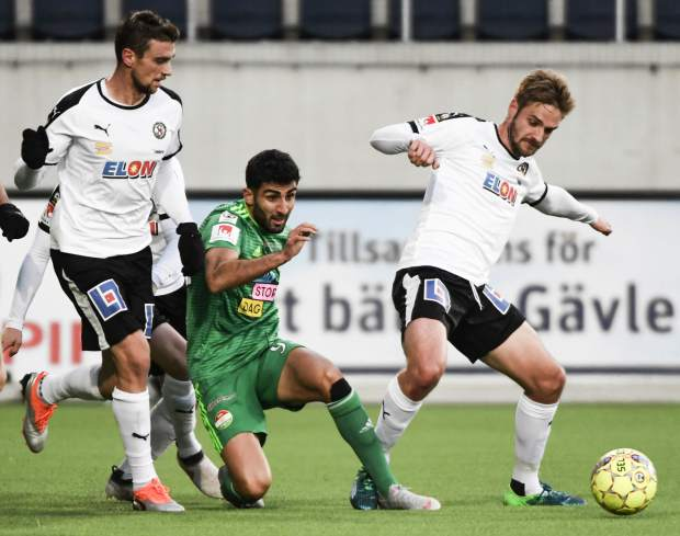Dalkurd's Ferhad Ayaz, center, battles with Orebro players during their Swedish League soccer match on Saturday at Gavlevallen soccer field in Gavle, Sweden. The 14-year journey of the soccer team known as Dalkurd began as a social project to get misbehaving kids off the street in a rural town in central Sweden. Now, it has grown into a top-flight squad that has given the Kurdish minority - scattered and ravaged by war - something to cherish as its own.