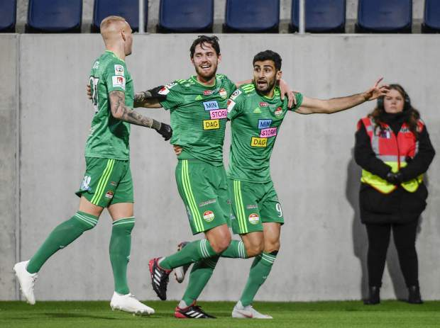 Dalkurds Robin Tranberg, center, celebrates scoring with teammates Adam Stahl, left, and Eero Markkanen, during their Swedish League soccer match on Saturday between Dalkurd and Orebro at Gavlevallen soccer field in Gavle, Sweden. The 14-year journey of the soccer team known as Dalkurd began as a social project to get misbehaving kids off the street in a rural town in central Sweden. Now, it has grown into a top-flight squad that has given the Kurdish minority - scattered and ravaged by war - something to cherish as its own.