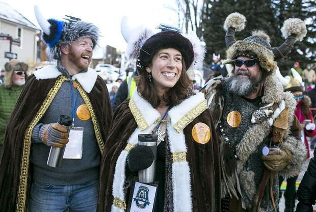 Ullr King Joe Howdyshell, far left, and Ullr Queen Erin Gigliello, center, share laugh with Ullr, far right, Thursday, Jan. 11, on Main Street in Breckenridge.