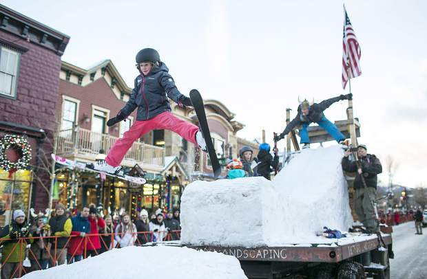 Kids ski off a jump on a rolling Thetford Landscape float during the Ullr Fest Parade Thursday, Jan. 11, on Main Street in Breckenridge.