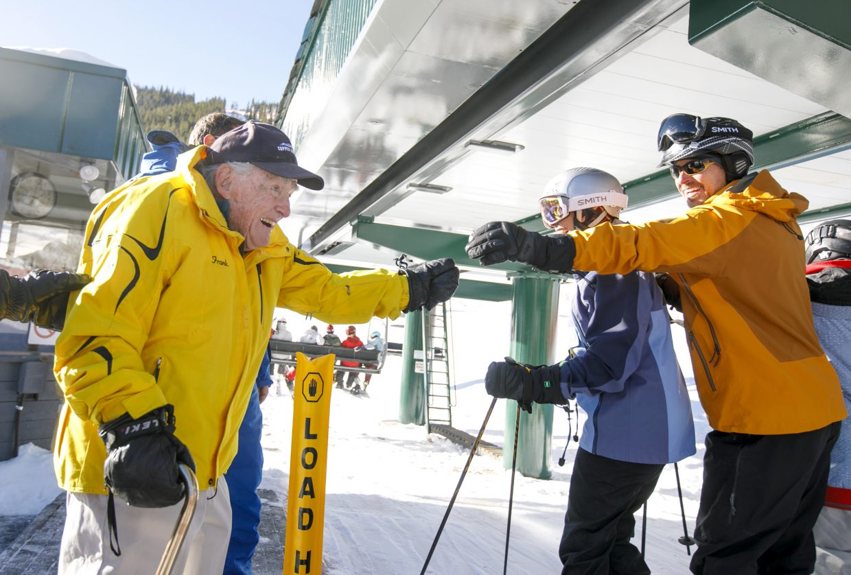 Copper Mountain resident Frank Walter, 96, greets the first chairlift riders of the 2018-2019 season Friday, Nov. 16, at Copper Mountain.