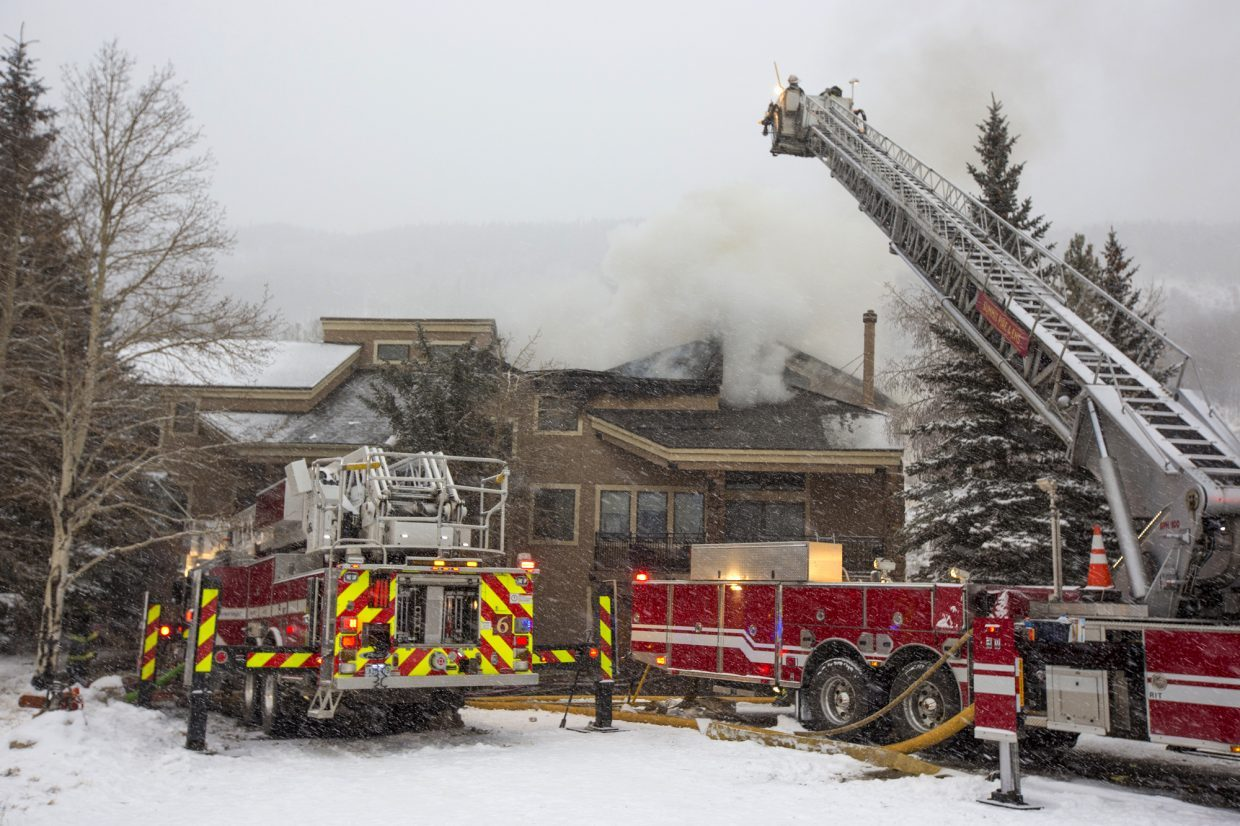 Summit Fire and EMS Department works to put out the fire at the Enclave Condos Friday morning, Nov. 23, near Keystone Ski Resort. The fire was reported at 6 a.m. and no was was injured.
