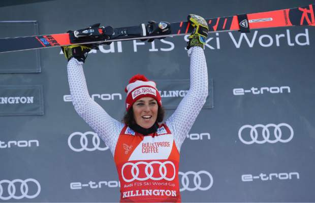 Italy's Federica Brignone celebrates on the podium after winning the alpine ski, women's World Cup giant slalom in Killington, Vt., on Saturday, Nov. 24.