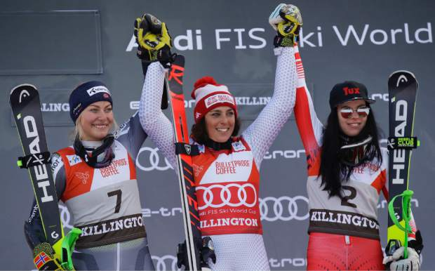Italy's Federica Brignone, center, winner of the alpine ski women's World Cup giant slalom, celebrates on the podium with second placed Norway's Ragnhild Mowinckel, left, and third placed Austria's Stephanie Brunner, in Killington, Vt., on Saturday, Nov. 24.
