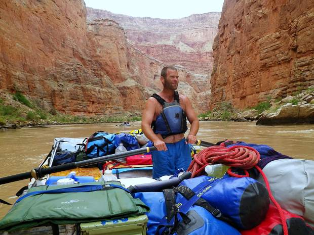 Dave Repsher mans the oars during a rafting trip through the Grand Canyon in this photo provided by Dave and Amanda Repsher. Dave Repsher was badly burned in a July 2015 Flight For Life helicopter crash and has been fighting to reclaim pieces of his life ever since. One major step was moving home to Silverthorne. Another one will be getting back on the water.