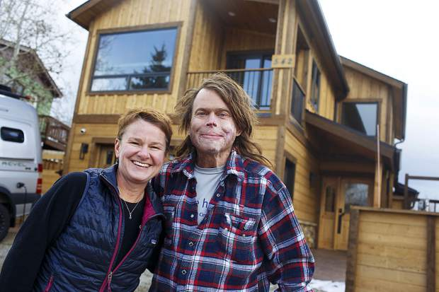 Amanda and Dave Repsher stand in front of their newly remodeled home Saturday, Nov. 17, in Silverthorne. Coming home was a major step for the couple as they try to reclaim pieces of their lives lost in a July 2015 helicopter crash in Frisco.
