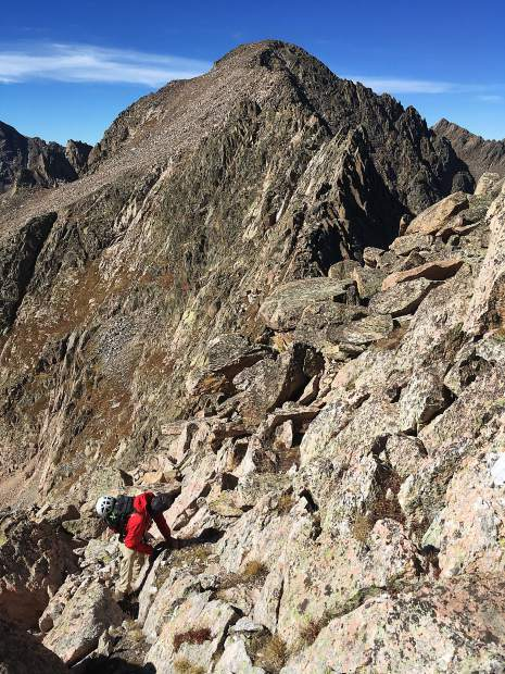 Summit County local Gary Fondl traverses between the 12,800-foot-plus summits of Peaks R and S deep in the Gore Range.